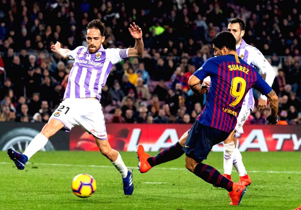BARCELONA, Feb. 17, 2019 - Barcelona's Luis Suarez (R) shoots during a Spanish league match between FC Barcelona and Valladolid in Barcelona, Spain, on Feb. 16, 2019. FC Barcelona won 1-0.