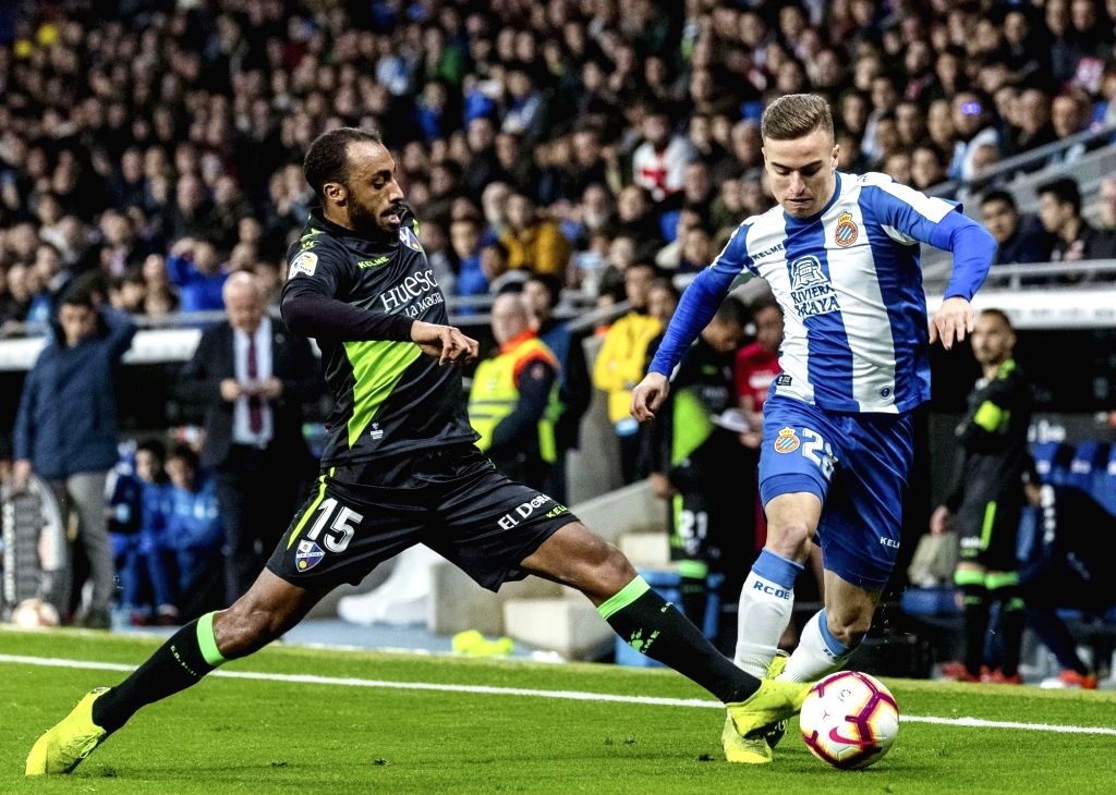 BARCELONA, Feb. 22, 2019 - Espanyol's Adria Pedrosa (R) competes with Huesca's Carlos Akapo  during a Spanish league match between Espanyol and Huesca in Barcelona, Spain, Feb.22, 2019.