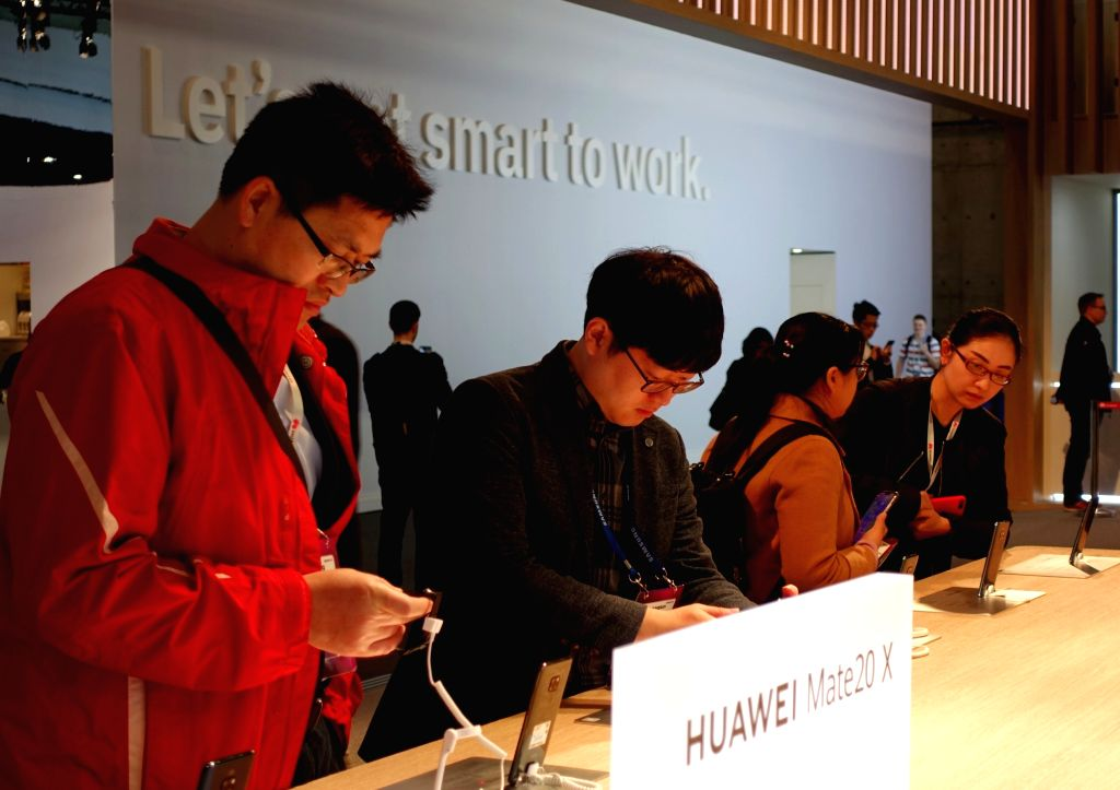 BARCELONA, Feb. 25, 2019 - People are seen at the booth of Chinese tech company Huawei at the 2019 Mobile World Congress (MWC) in Barcelona, Spain, Feb. 25, 2019. The four-day 2019 MWC opened on ...