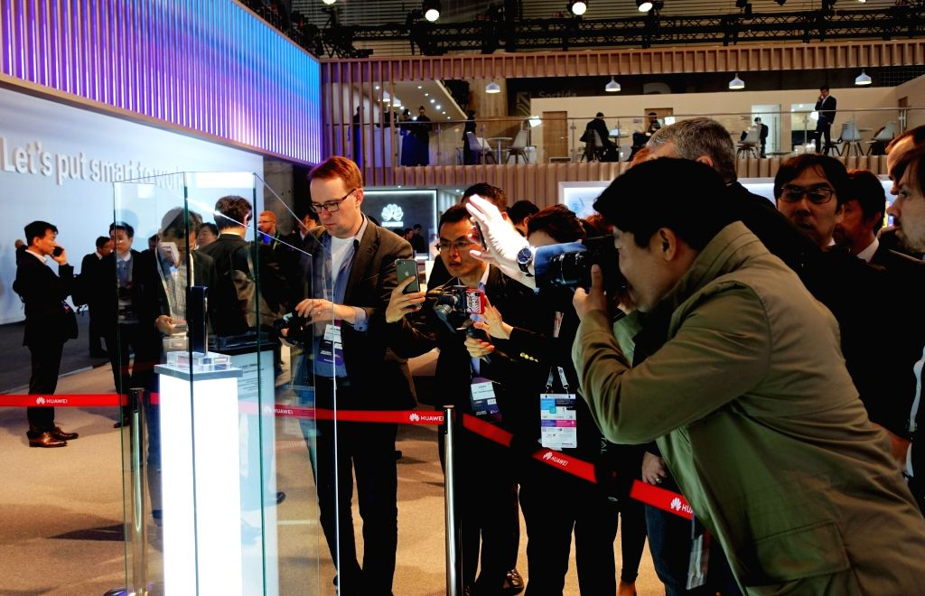 BARCELONA, Feb. 25, 2019 - Visitors take images of Huawei's new foldable 5G ready smartphone Mate X at the Mobile World Congress (MWC) in Barcelona, Spain, Feb. 25, 2019. Chinese tech company Huawei ...