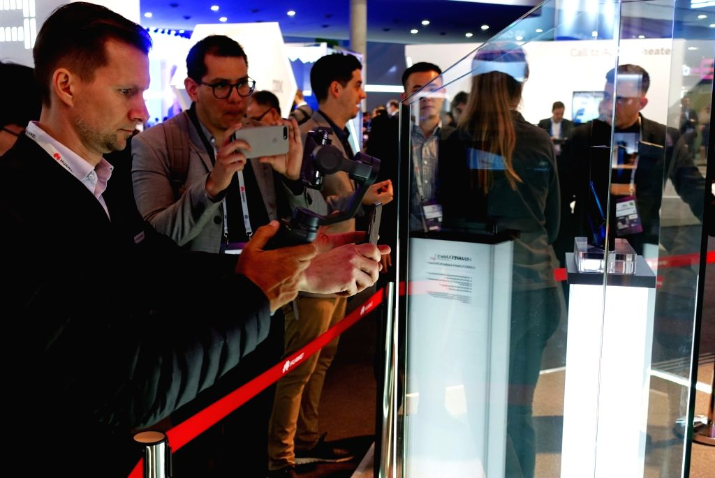 BARCELONA, Feb. 25, 2019 - Visitors take pictures of a Huawei MATE X, a foldable 5G ready smartphone, displayed at the 2019 Mobile World Congress (MWC) in Barcelona, Spain, Feb. 25, 2019. The ...
