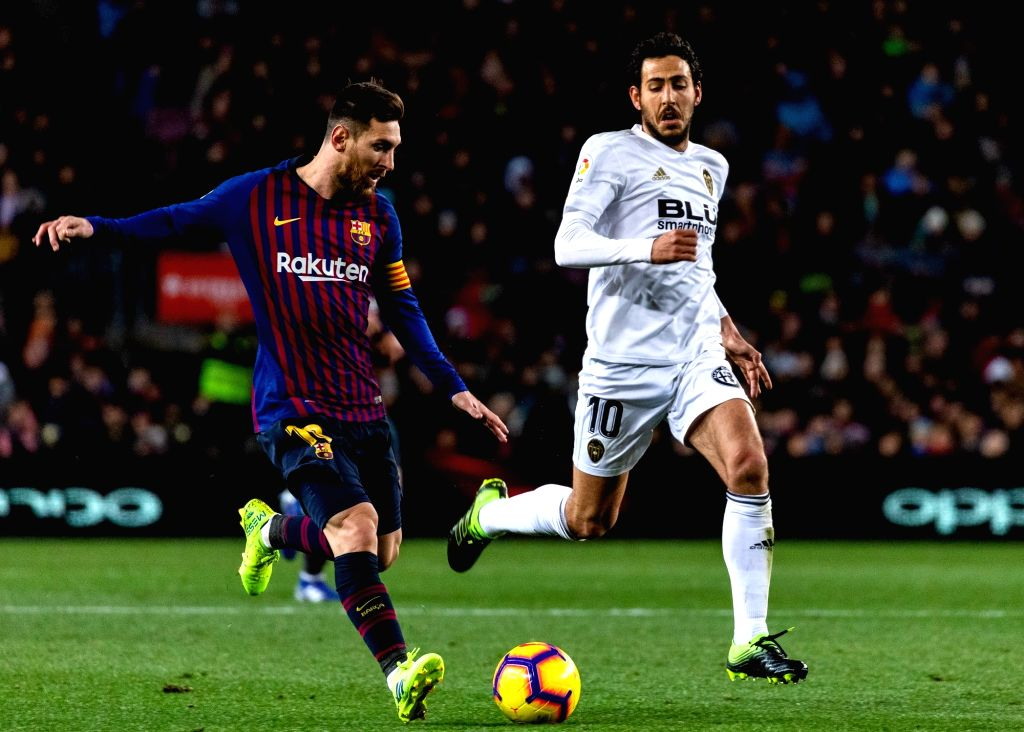 BARCELONA, Feb. 3, 2019 - FC Barcelona's Lionel Messi (L) competes during a Spanish La Liga match between FC Barcelona and Valencia in Barcelona, Spain, on Feb. 2, 2019.