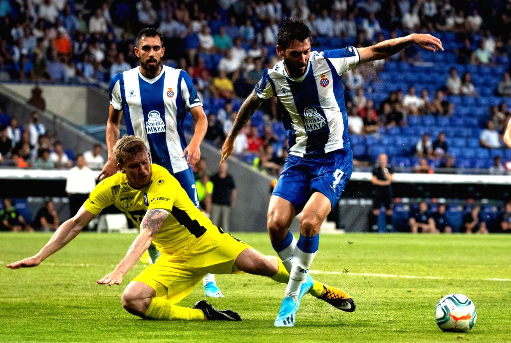BARCELONA, July 26, 2019 - RCD Espanyol's Facundo Ferreyra (R) vies with Stjarnan's Johann Laxdal (C) during the Europa League qualifying second round between RCD Espanyol of Spain and Stjarnan of ...