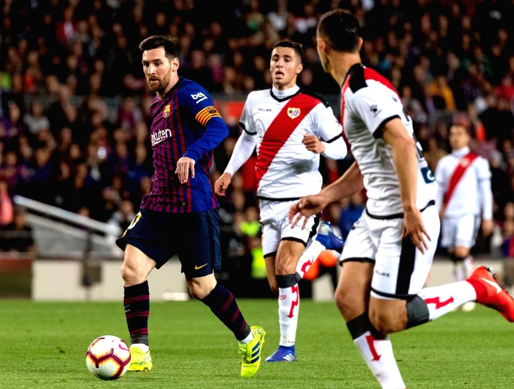 BARCELONA, March 10, 2019 - FC Barcelona's Lionel Messi (L) controls the ball during a Spanish La Liga match between FC Barcelona and Rayo Vallecano in Barcelona, Spain, on March 9, 2019. Barcelona ...
