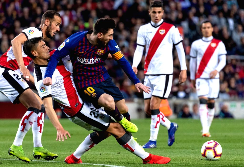 BARCELONA, March 10, 2019 - FC Barcelona's Lionel Messi (3rd L) vies with Rayo Vallecano's Emiliano Velazquez (2nd L) during a Spanish La Liga match between FC Barcelona and Rayo Vallecano in ...