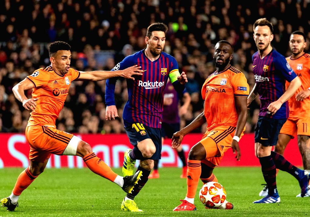 BARCELONA, March 14, 2019 - Barcelona's Lionel Messi (2nd L) competes with Lyon's Fernando Marcal (1st L) and Tanguy NDombele (3rd L) during the UEFA Champions League match between Spanish team FC ...