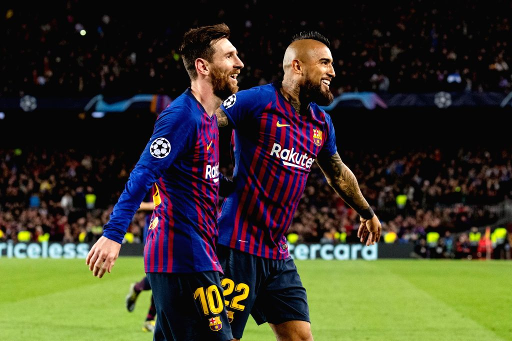 BARCELONA, March 14, 2019 - Barcelona's Lionel Messi (L) and Arturo Vidal celebrate a goal by teammate Gerard Pique during the UEFA Champions League match between Spanish team FC Barcelona and French ...