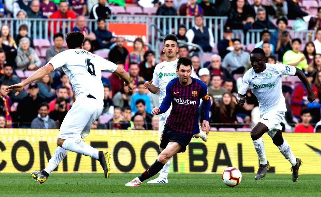 BARCELONA, May 13, 2019 - Barcelona's Lionel Messi (2nd L) competes during a Spanish league match between FC Barcelona and Getafe in Barcelona, Spain, on May 12, 2019. FC Barcelona won 2-0.