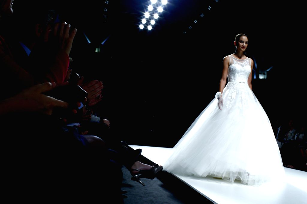 A model presents a creation by Spanish brand Yolan Cris at the Barcelona Bridal Week in Barcelona, May 7, 2014. The Barcelona Bridal Week runs from May 6 to 11.