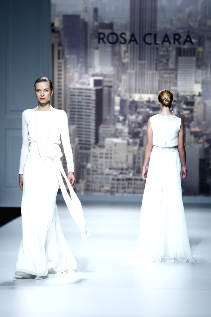 Models present creations by Spanish brand Yolan Cris at the Barcelona Bridal Week in Barcelona, May 7, 2014. The Barcelona Bridal Week runs from May 6 to 11.