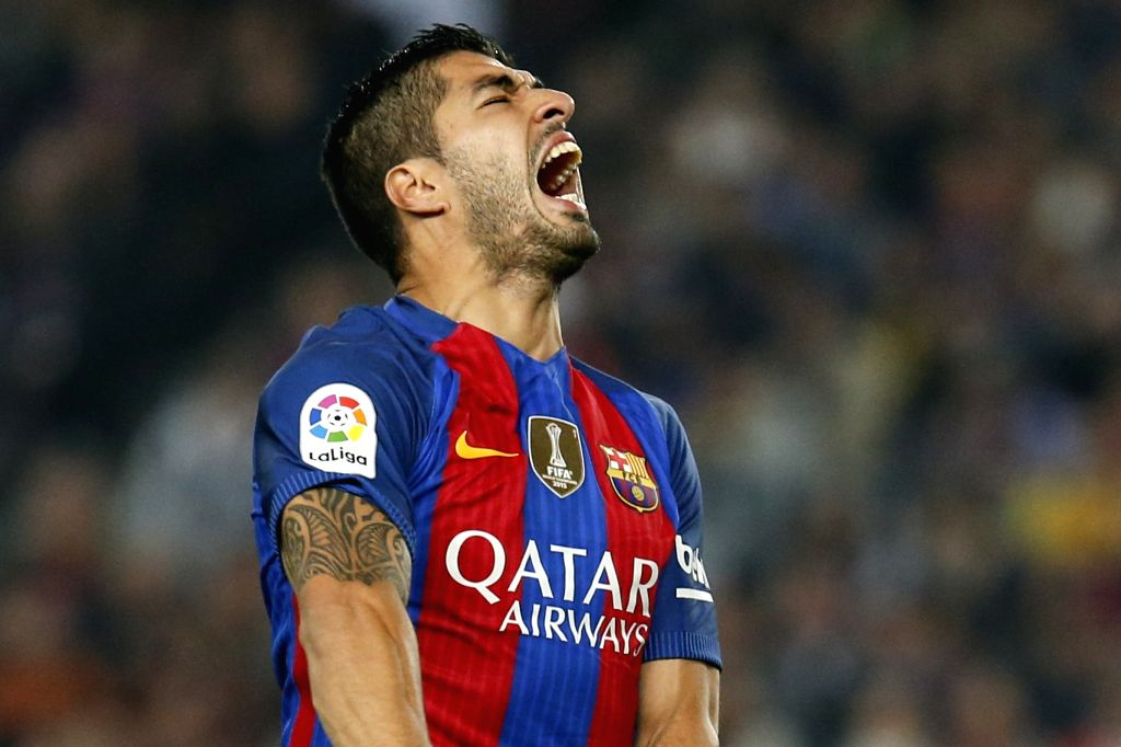 BARCELONA, Oct. 30, 2016 - Barcelona's Luis Suarez reacts after missing a goal opportunity during the Spanish league football match between FC Barcelona and Granada FC in Barcelona, Spain, on Oct. ...
