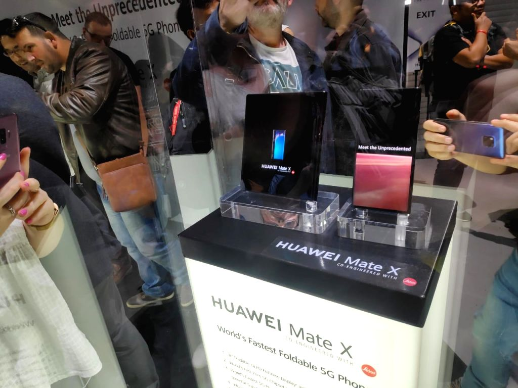Barcelona: People checkout the newly launched Huawei Mate X 5G foldable phone at the Mobile World Congress 2019 in Barcelona, Spain on Feb 24, 2019. (Photo: IANS)