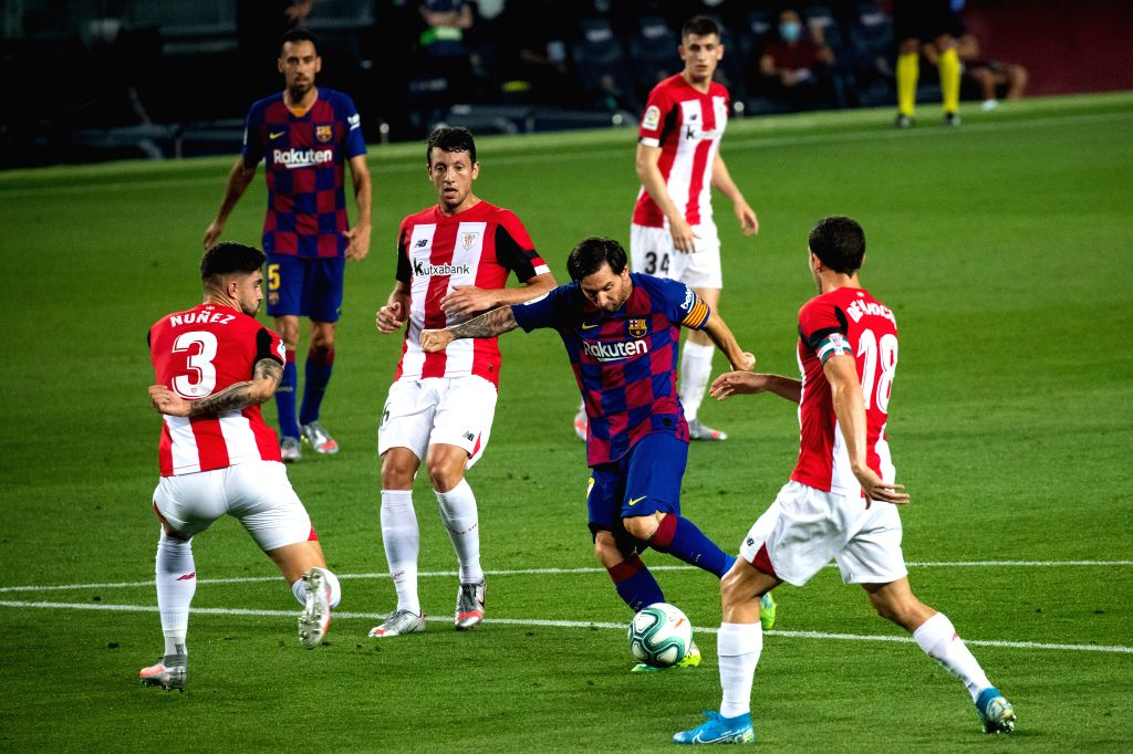 Barcelona's Lionel Messi (2nd R, front) controls the ball during a Spanish league football match between Barcelona and Athletic Bilbao in Barcelona, Spain, June ...