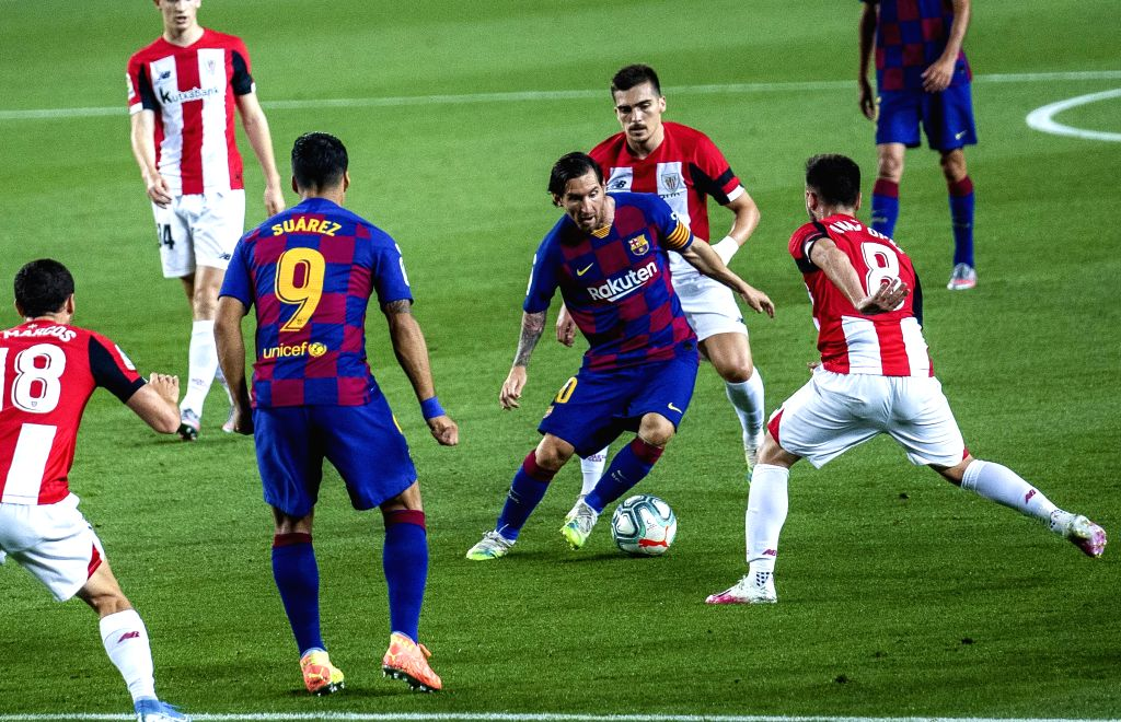 Barcelona's Lionel Messi (3rd R) controls the ball during a Spanish league football match between Barcelona and Athletic Bilbao in Barcelona, Spain, June 23, 2020.