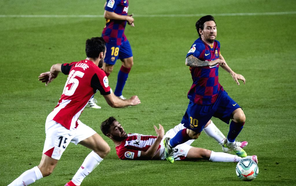 Barcelona's Lionel Messi (R) breaks through during a Spanish league football match between Barcelona and Athletic Bilbao in Barcelona, Spain, June 23, 2020.
