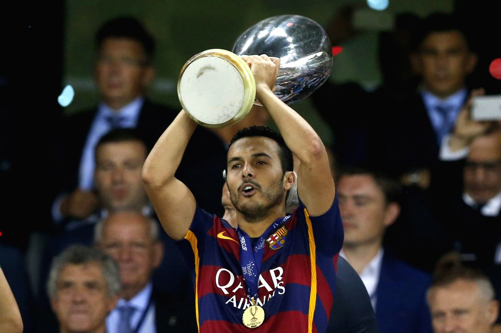 Barcelona's Pedro (c) celebrates with the trophy during the UEFA Super Cup match between Barcelona and Sevilla at Boris Paichadze Dinamo Arena in Tbilisi, Georgia, 11 August 2015. ...