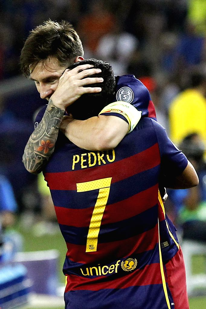 Barcelona's Pedro Rodriguez (L) and Lionel Messi celebrate after winning the UEFA Super Cup match between FC Barcelona and Sevilla at Boris Paichadze Dinamo Arena in Tbilisi, Georgia, 11 ...