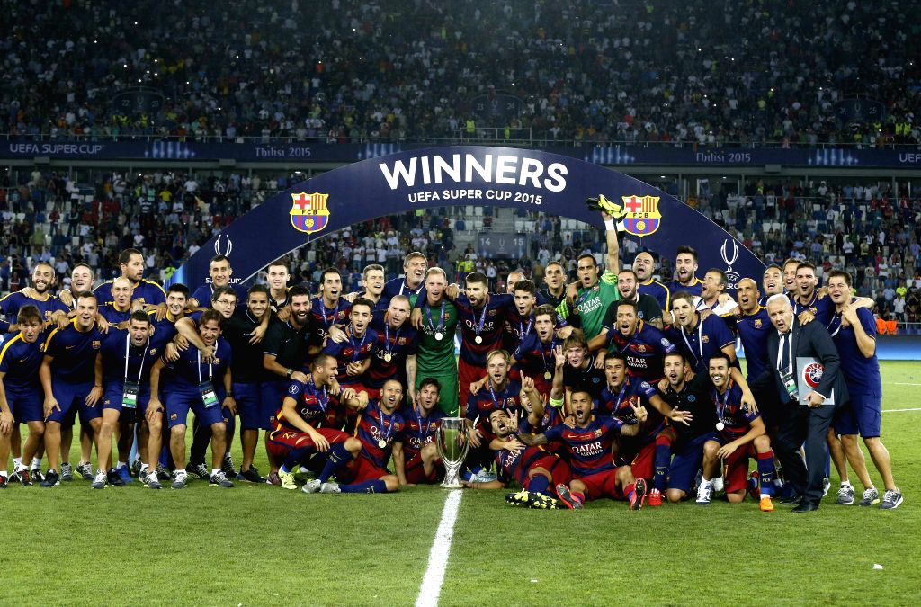 Barcelona's team players celebrate with the trophy during the UEFA Super Cup match between Barcelona and Sevilla at Boris Paichadze Dinamo Arena in Tbilisi, Georgia, 11 August 2015. ...