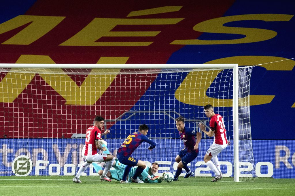 Barcelona's Ter Stegen (C) saves the ball during a Spanish league football match between Barcelona and Athletic Bilbao in Barcelona, Spain, June 23, 2020.