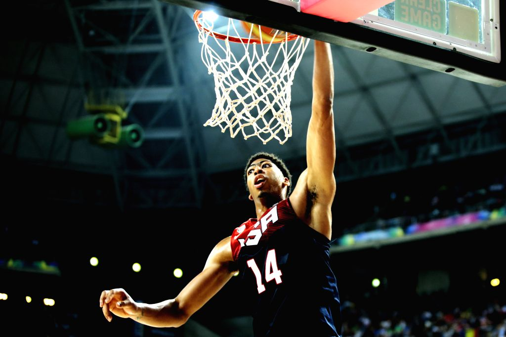 Anthony Davis of the United States scores during the quarterfinal with Slovenia at the 2014 FIBA Basketball World Cup Spain in Barcelona Sept. 10, 2014. ...