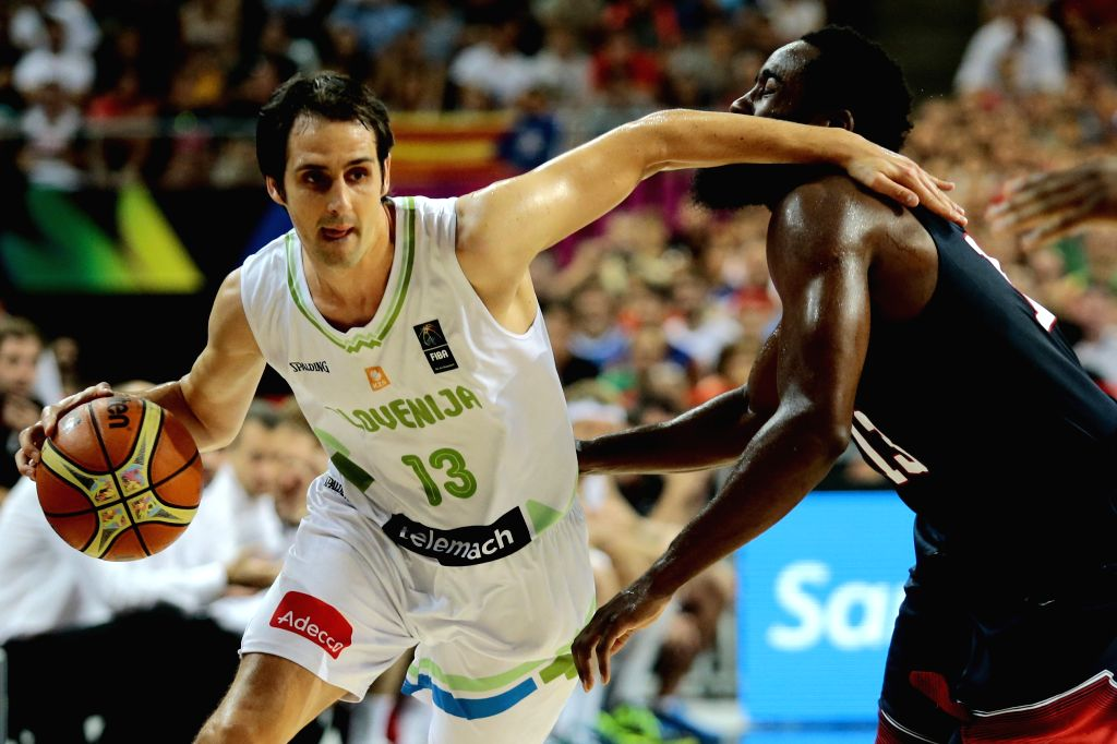Domen Lorbek (L) of Slovenia drives the ball in front of James Harden (R) of the United States during a quarterfinal of the 2014 FIBA Basketball World Cup Spain .