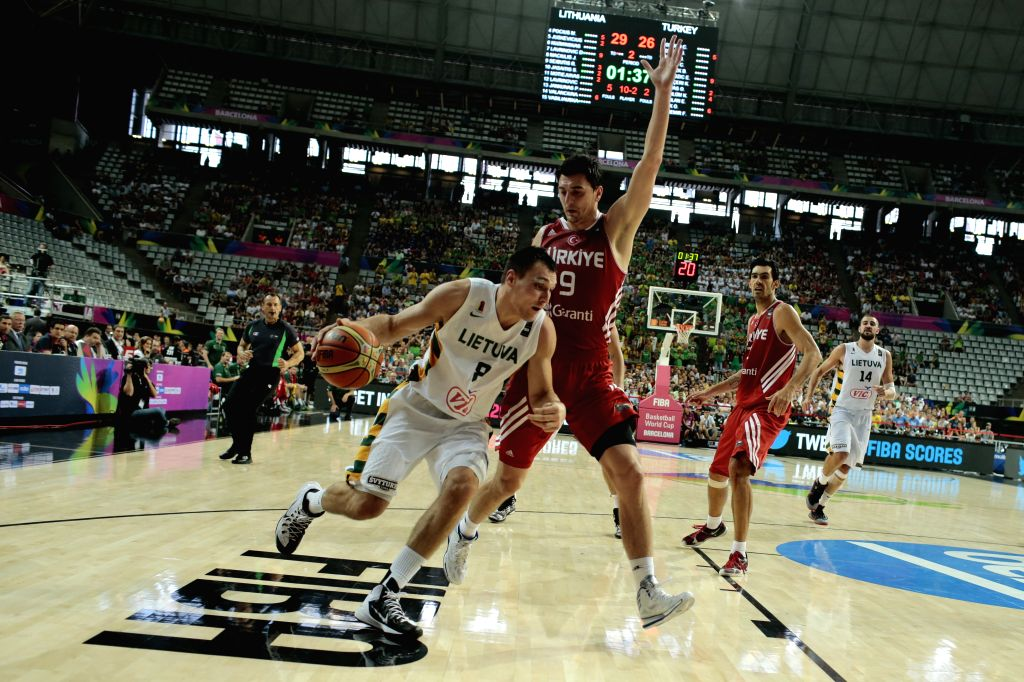 Jonas Maciulis (L) of Lithuania drives the ball in front of Emir Preldzic of Turkey during the quarterfinal match at the 2014 FIBA Basketball World Cup Spain, in