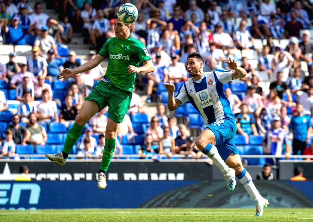 BARCELONA, Sept. 23, 2019 - RCD Espanyol's Jonathan Calleri (R) competes with Real Sociedad's Aritz Elustondo during a Spanish league match between RCD Espanyol and Real Sociedad in Barcelona, Spain, ...