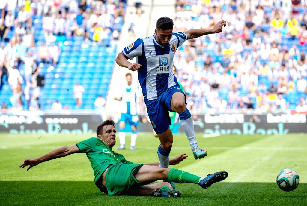 BARCELONA, Sept. 23, 2019 - RCD Espanyol's Jonathan Calleri (R) competes with Real Sociedad's Diego Llorente during a Spanish league match between RCD Espanyol and Real Sociedad in Barcelona, Spain, ...