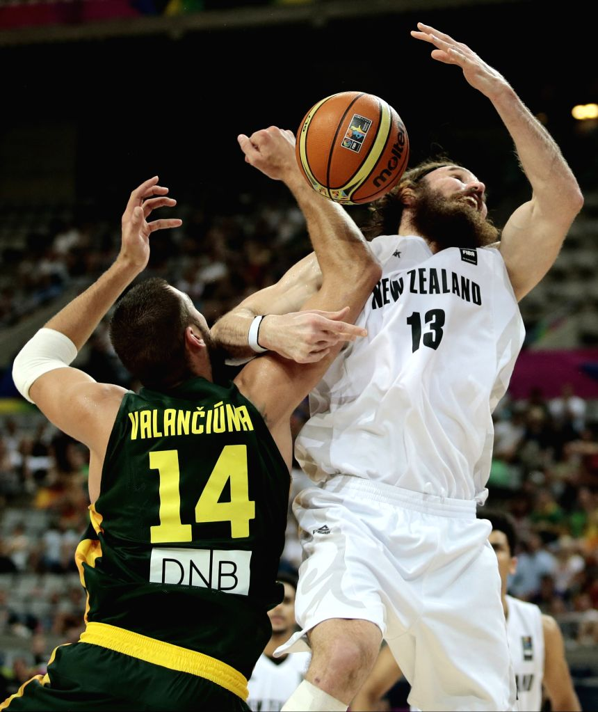 Casey Frank (R) of New Zealand vies for the ball with Jonas Valanciunas of Lithuania during the Round of 16 match of the 2014 FIBA Basketball World Cup Spain, in .