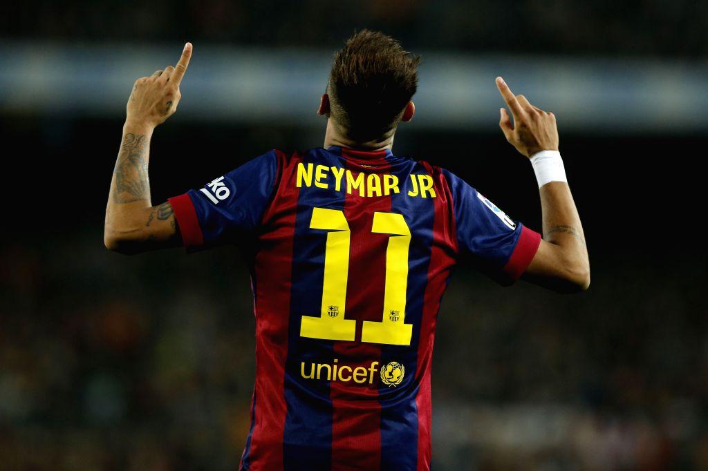 Barcelona (Spain):Barcelona : Barcelona's Neymar celebrates for scoring during the Spanish first division soccer match against Sevilla at the Camp Nou Stadium, in Barcelona, Spain, on Nov. 22, ...