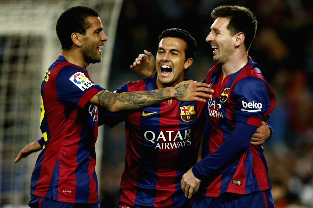Barcelona (Spain): Barcelona's Argentine forward Lionel Messi (R) celebrates his goal with teammates during the Spanish first division soccer match against FC Espanol at the Camp Nou Stadium in ...