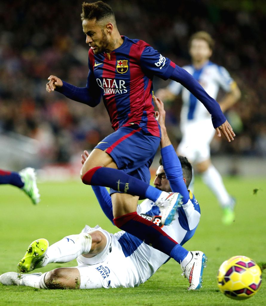 Barcelona (Spain): Barcelona's Brazilian forward Neymar (Top) vies for the ball during the Spanish first division soccer match against FC Espanol at the Camp Nou Stadium in Barcelona, Spain, on Dec. .