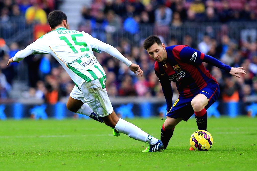 Barcelona (Spain):FC Barcelona player Lionel Messi (right) in action during the La Liga match between FC Barcelona and Cordoba CF at Camp Nou in Barcelona, Spain on Dec 21, 2014.