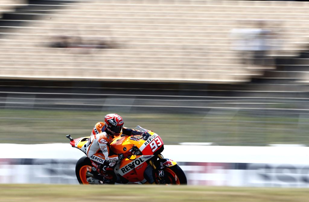 Barcelona: Spanish Moto GP driver Marc Marquez of Repsol Honda during the free training session held at the Catalunya track of Montmelo, Barcelona, Spain on 12 June 2015. The Catalunya GP will be held on 14 June 2015. (IANS/EFE/Alejandro Garcia)