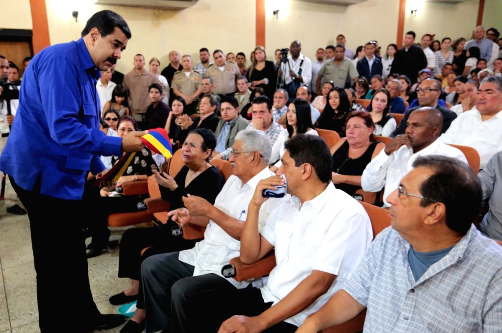 BARINAS, July 20, 2016 - Image provided by the Venezuelan Presidency shows President Nicolas Maduro (R) interacting with relatives during the funeral of Anibal Chavez, brother of late Venezuelan ...