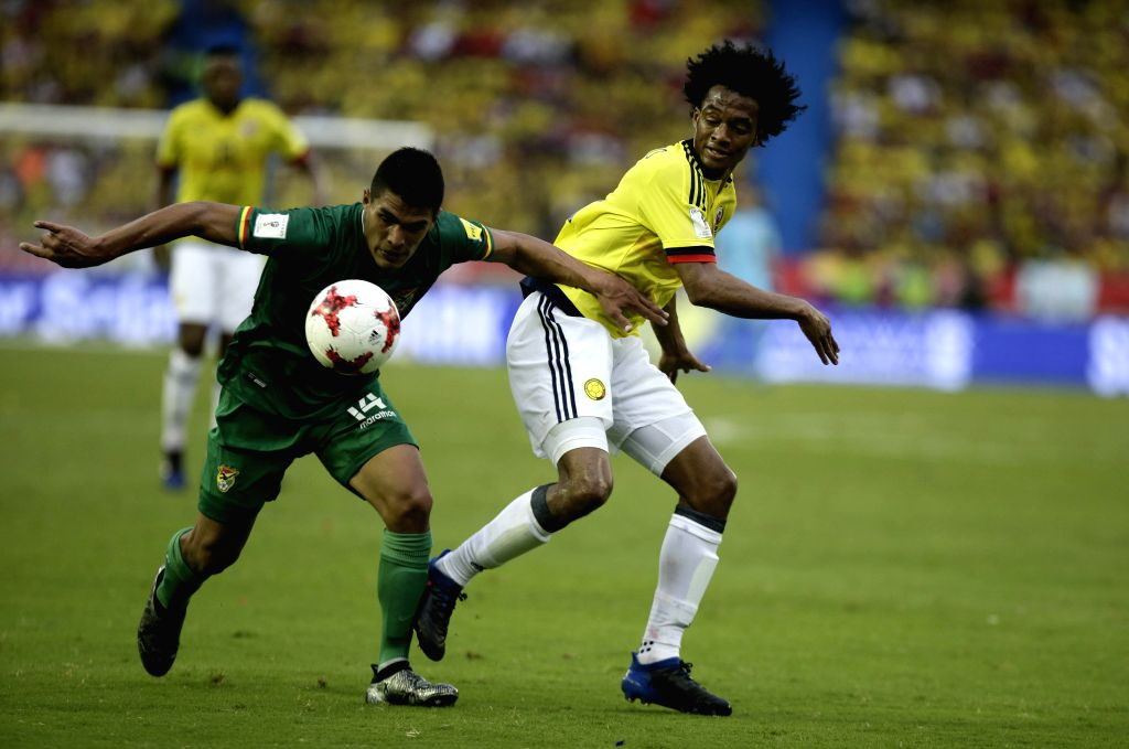 BARRANQUILLA, March 24, 2017 - Colombia's Carlos Sanchez (R) vies for the ball with Bolivia's Juan Pablo Aponte (L), during the match for the South American qualifiers for the Russia 2018 FIFA World ...