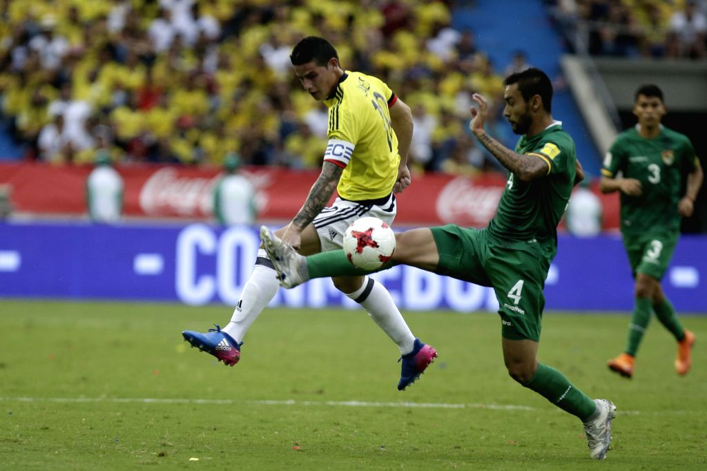 BARRANQUILLA, March 24, 2017 - Colombia's James Rodriguez (L) vies for the ball with Bolivia's Cristian Coimbra (R), during the match for the South American qualifiers for the Russia 2018 FIFA World ...