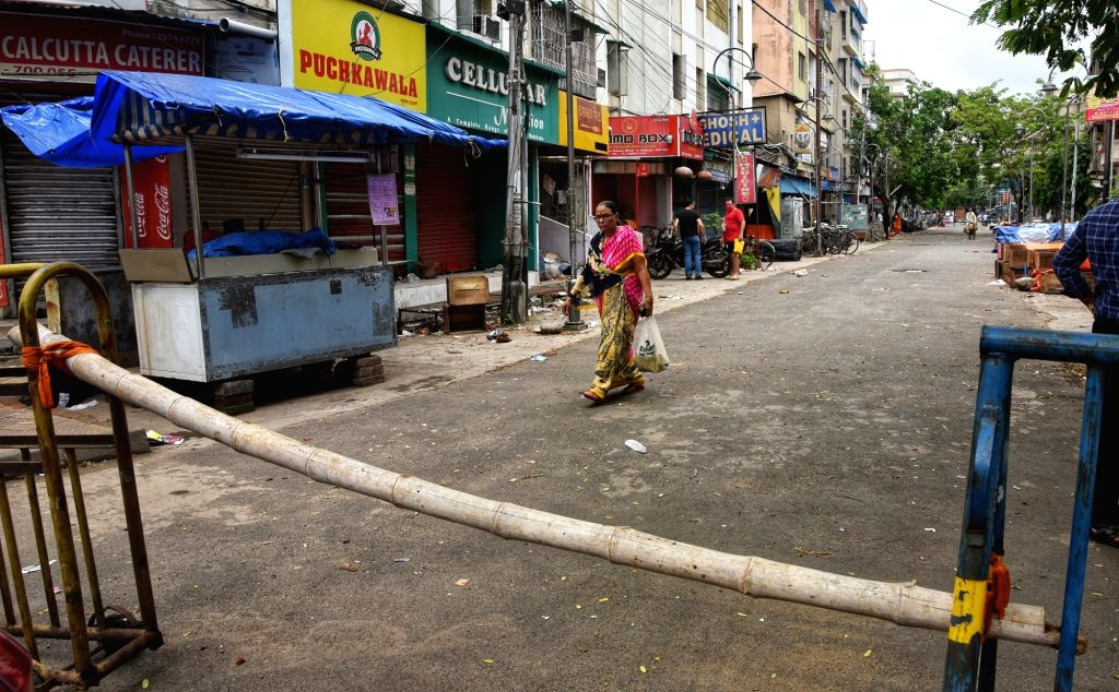 Barricades placed in a COVID-19 containment zone at Kolkata's Bangur Avenue Super market area during a complete lockdown imposed in all the designated containment zones across West Bengal, ...