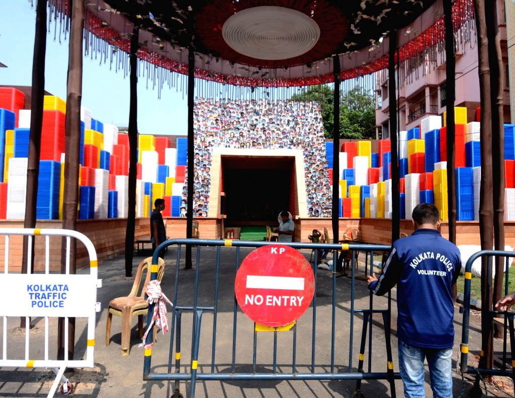 Barricades put up outside the Beleghata Sandhani Club ahead of Durga Puja celebrations, in Kolkata on Oct 20, 2020. This comes close on the heels of the Calcutta High Court's orders on ...