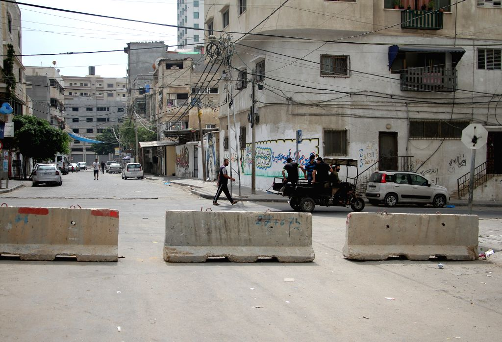 Barriers are placed on a road during the lockdown to curb the spread of COVID-19 in Gaza City, on Aug. 30, 2020. Palestine on Sunday recorded 536 new COVID-19 cases, ...