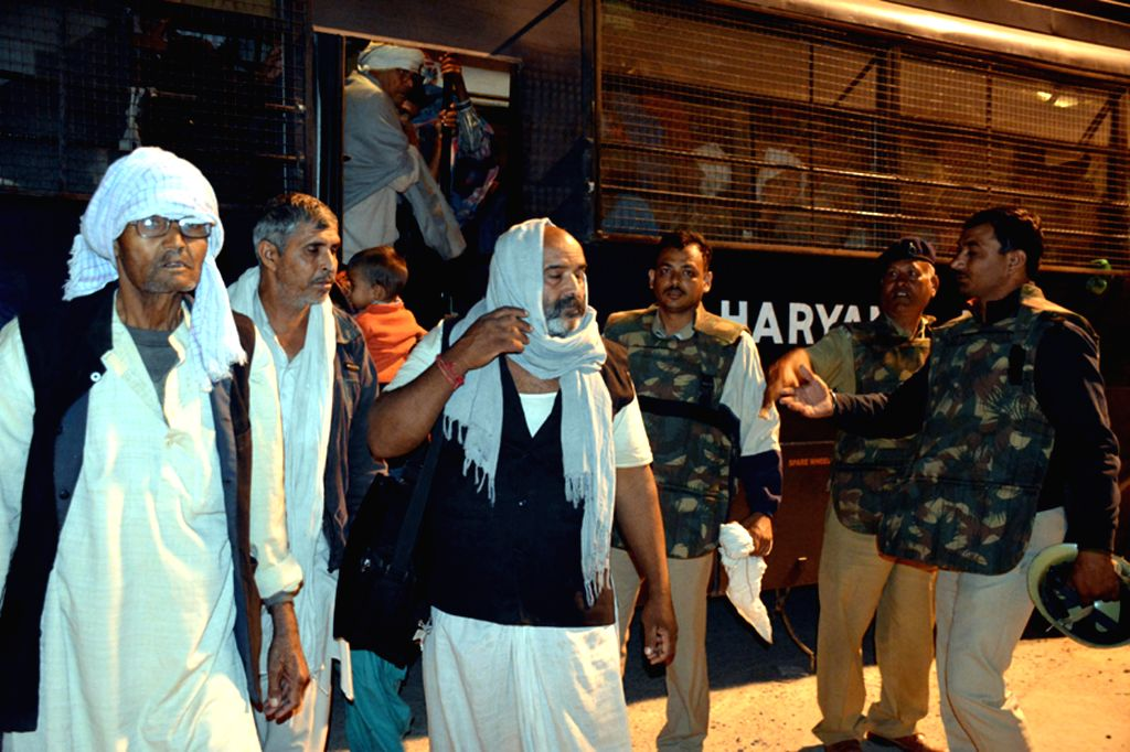 Followers of controversial sect leader Rampal come out of Satlok Ashram near Barwala town in Haryana's Hisar district, 210 km from Chandigarh on Nov 19, 2014.