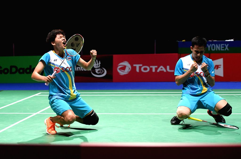 BASEL, Aug. 25, 2019 - Dechapol Puavaranukroh/Sapsiree Taerattanachai (L) of Thailand celebrate after the mixed doubles semifinal match against Wang Yilyu/Huang Dongping of China at the BWF Badminton ...
