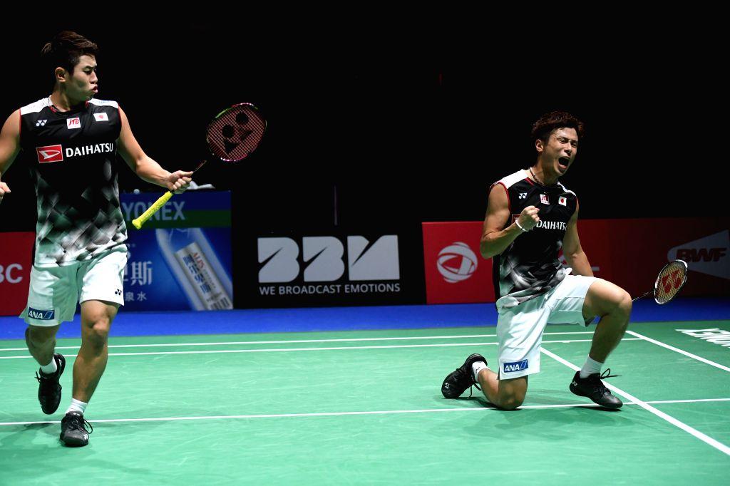 BASEL, Aug. 25, 2019 - Takuro Hoki/Yugo Kobayashi (R) of Japan celebrate after the men's doubles semifinal match against Li Junhui/Liu Yuchen of China at the BWF Badminton World Championships 2019 in ...