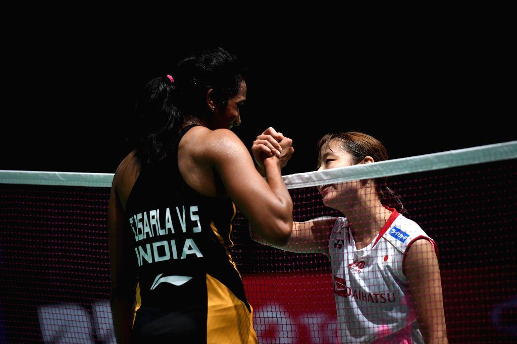 BASEL, Aug. 25, 2019 (Xinhua) -- India's Sindhu Pusarla V. (L) greets Japan's Okuhara Nozomi after the women's singles final match at the BWF Badminton World Championships 2019 in Basel, Switzerland, Aug. 25, 2019. (Xinhua/Li Jundong/IANS)