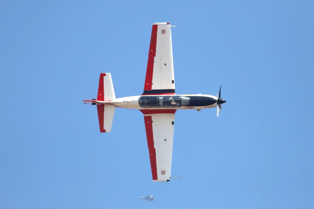 """Basic trainer HTT-40 perform during the inauguration of the """"Aero India 2019"""" - air show at Yelahanka Air Force Station, in Bengaluru, on Feb 20, 2019."""