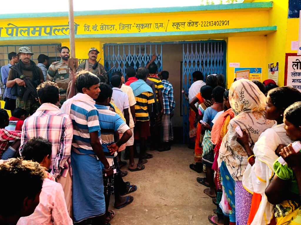 Bastar: People wait in a queue to cast their votes for the first phase of 2019 Lok Sabha elections, at a polling booth in Chhattisgarh's Bastar, on April 11, 2019. (Photo: IANS)