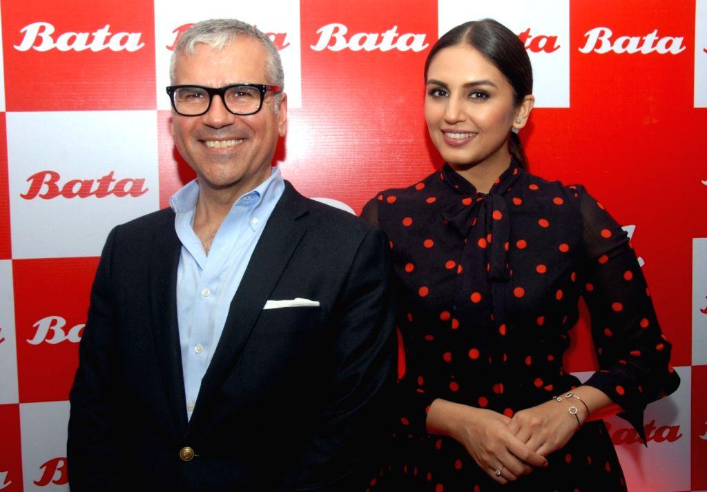 Bata Global CEO Alexis Nasard and actress Huma Qureshi at the launch of 1101st store of Bata in Bengaluru on June 2, 2016. - Huma Qureshi