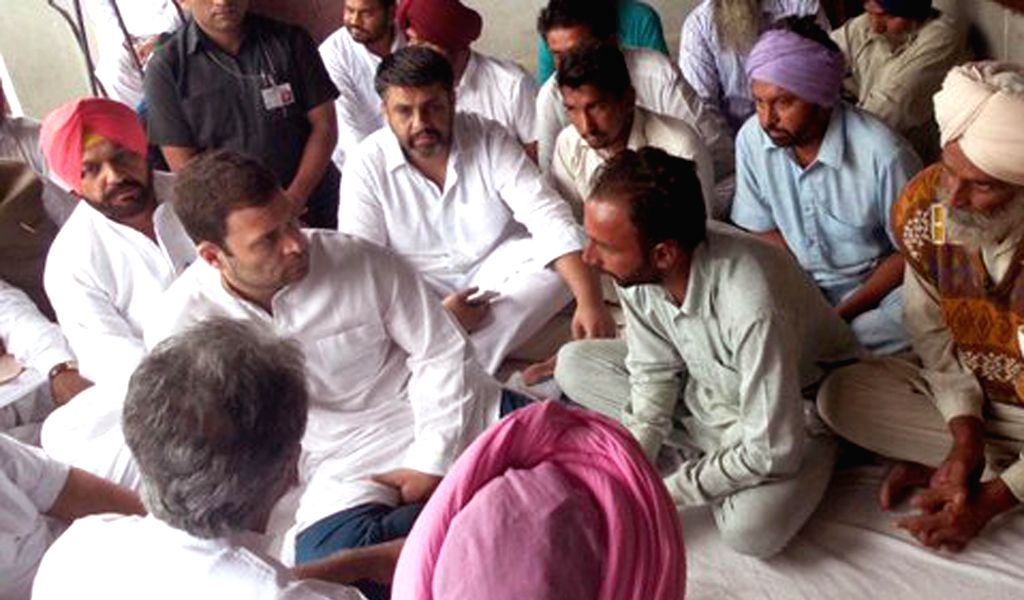 :Bathinda: Congress Vice President Rahul Gandhi meets with the family members of farmer Jagdev Singh who committed suicide due to crop failure, in Bathinda district of Punjab on Nov. 6, 2015. ... - Rahul Gandhi