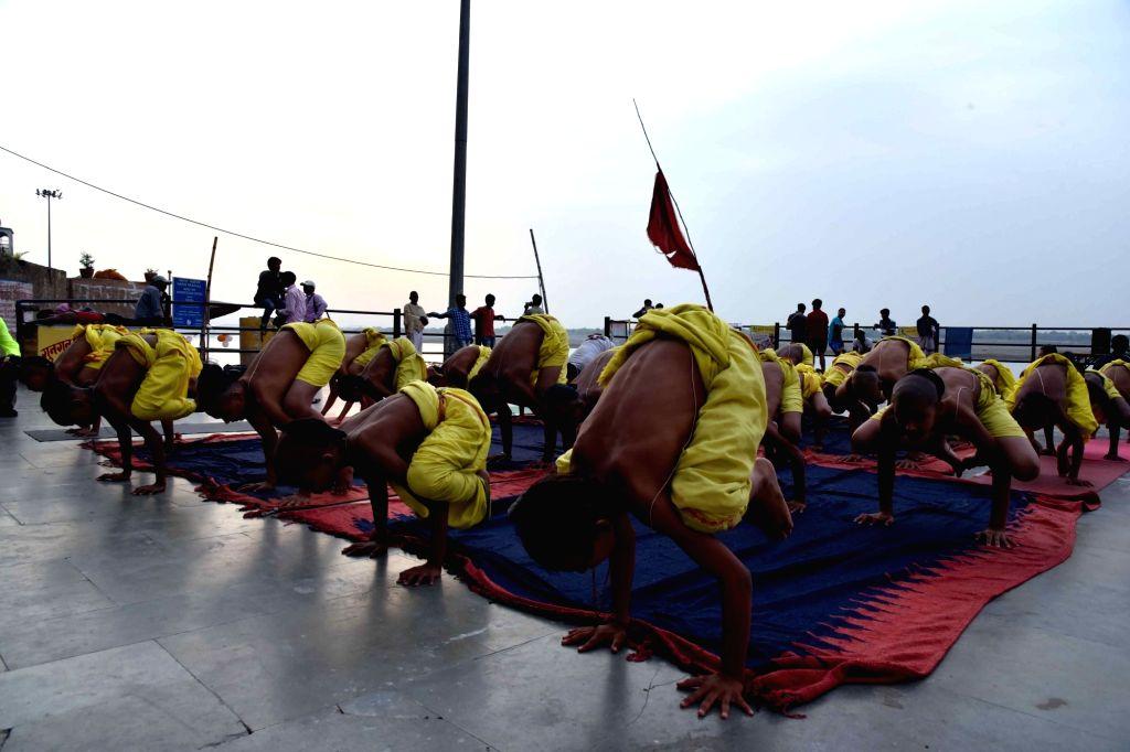 Batuks practice Yoga Asans -postures- on International Yoga Day in Varanasi on June 21, 2017. (