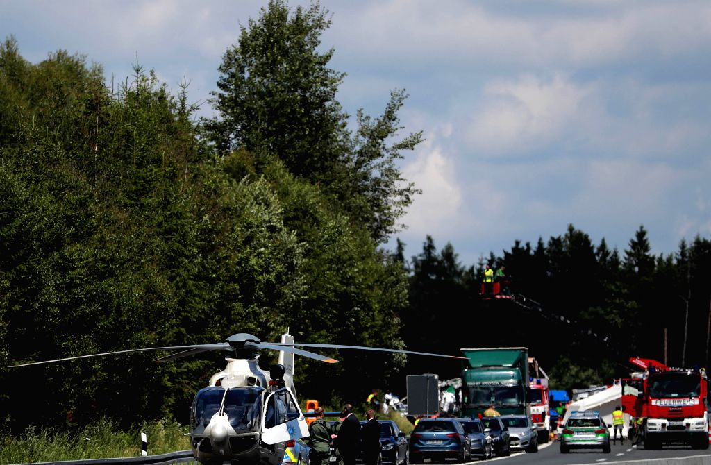 BAVARIA, July 3, 2017 - Rescuers work in the site of the bus-truck collision accident in Bavaria, Germany, on July 3, 2017. German police confirmed on Monday on the Twitter account that many people ...